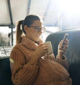 pregnant woman looking at her cell phone